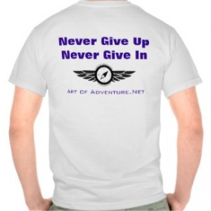 Never Give Up – Never Give In – Art of Adventure T-Shirt